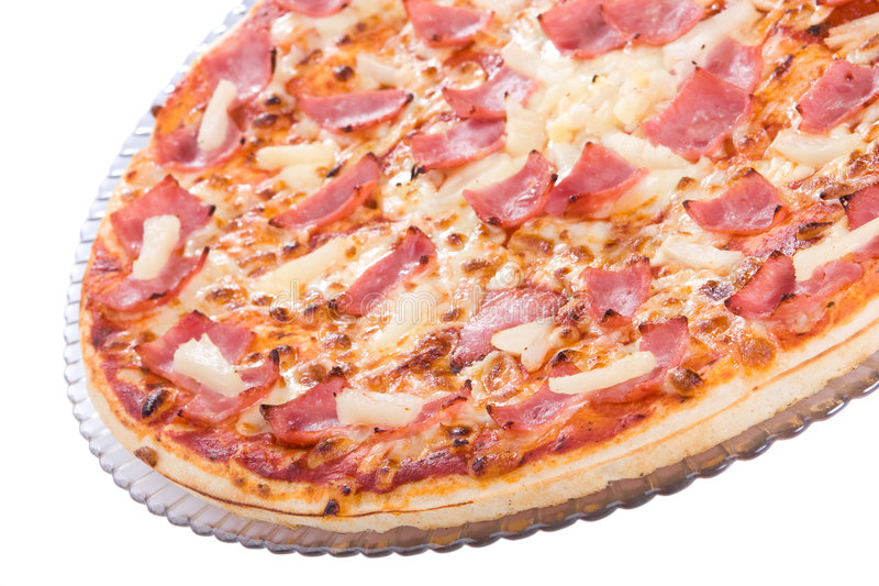 A pizza with pineapple, bacon and cheese stock images