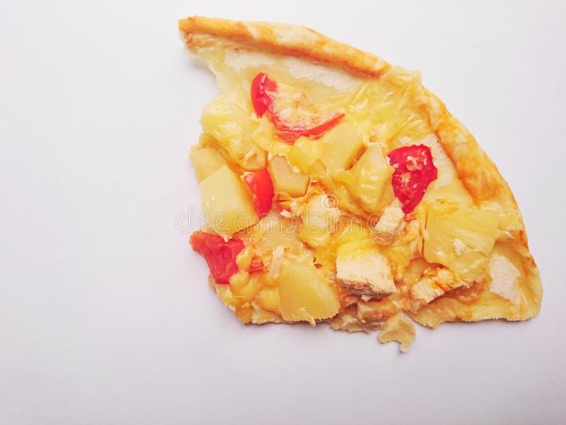 Pizza with pineapple, chicken, tomatoes and homemade cheese. royalty free stock photography