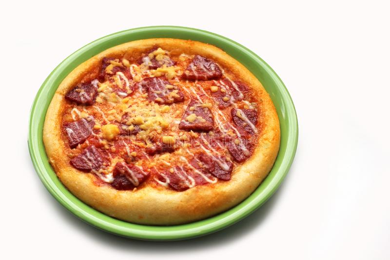 Pizza on a plate on a white background. stock image