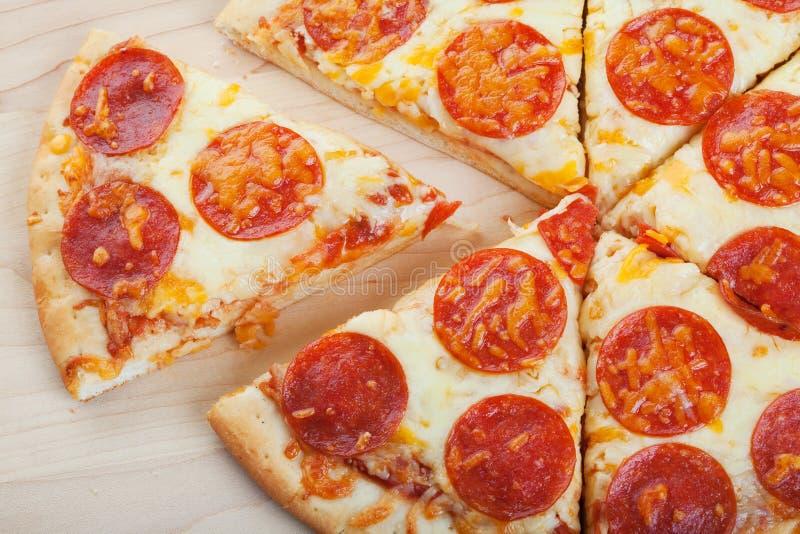 pizza pokrajać obraz stock