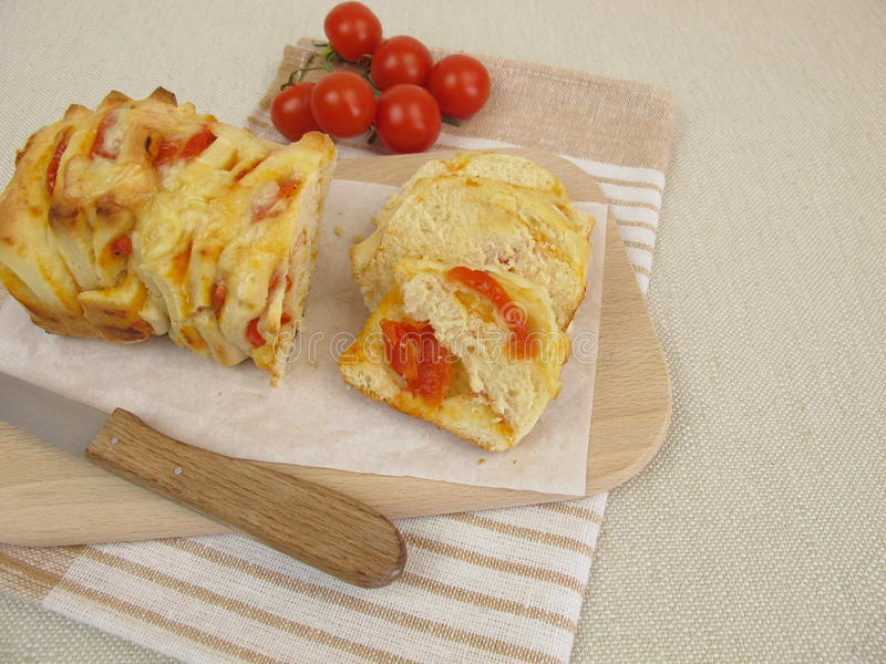 Pizza pull-apart bread with tomatoes and cheese royalty free stock photo
