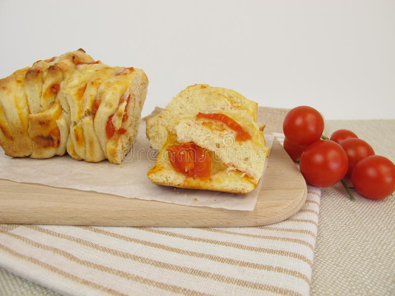 Pizza pull-apart bread with tomatoes and cheese royalty free stock photos