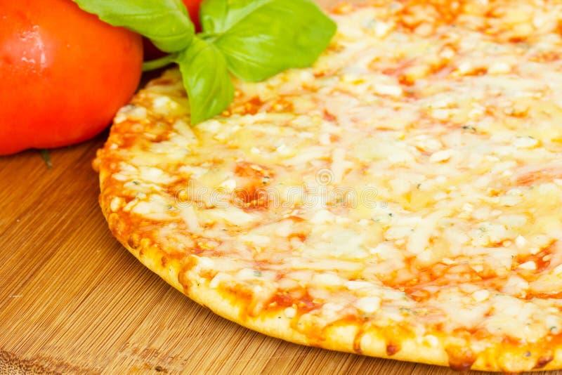 Pizza quatrro fromaggi (four cheese) stock photos