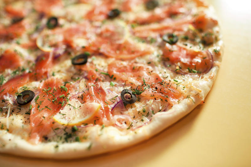 Pizza with red fish stock photo