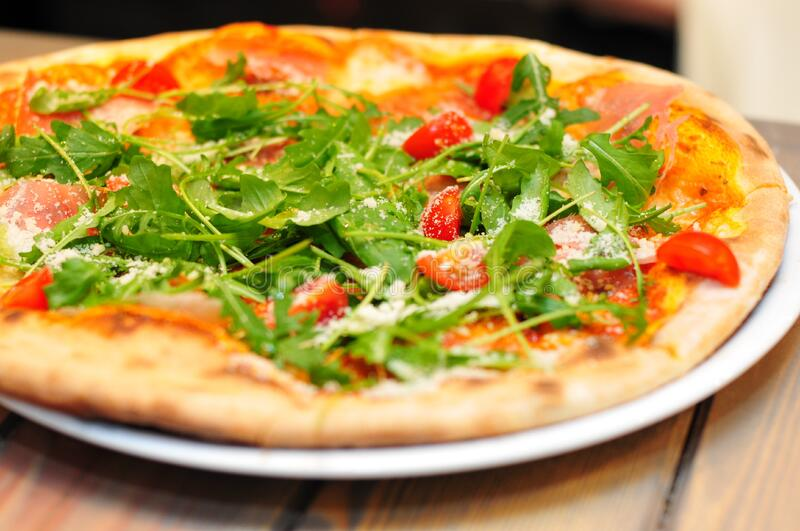 Pizza with rocket on top royalty free stock photography