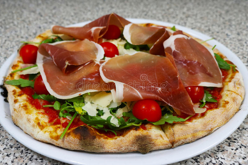 Pizza rucola,Raw ham,parmesan,restaurant italian. 2017 stock photo