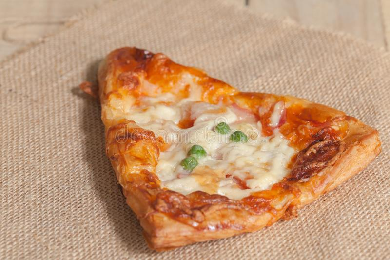 Pizza on sack cloth stock images