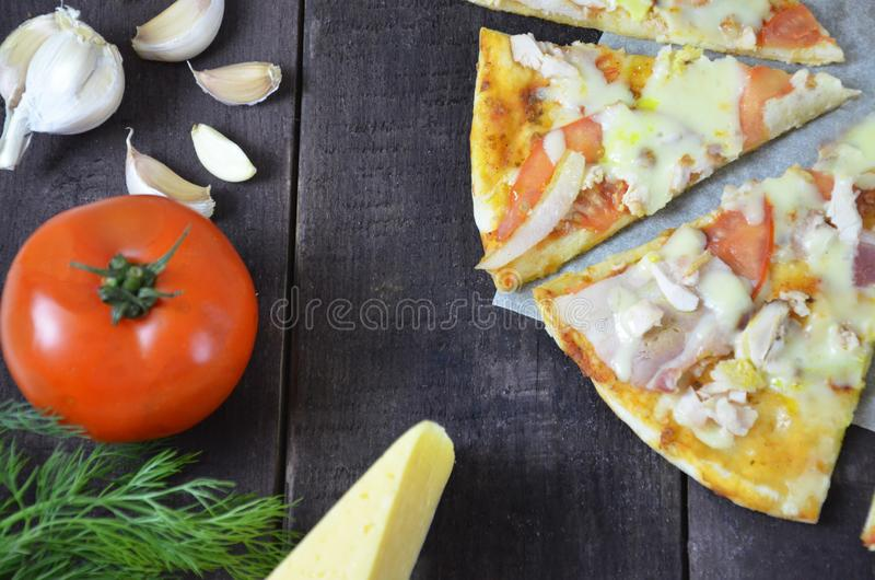 Pizza salami cheese ham. Hot Homemade Pepperoni Pizza Ready to Eat . with ingredients for cooking, greens, garlic, tomato, cheese. Pizza salami cheese ham. Hot royalty free stock photos
