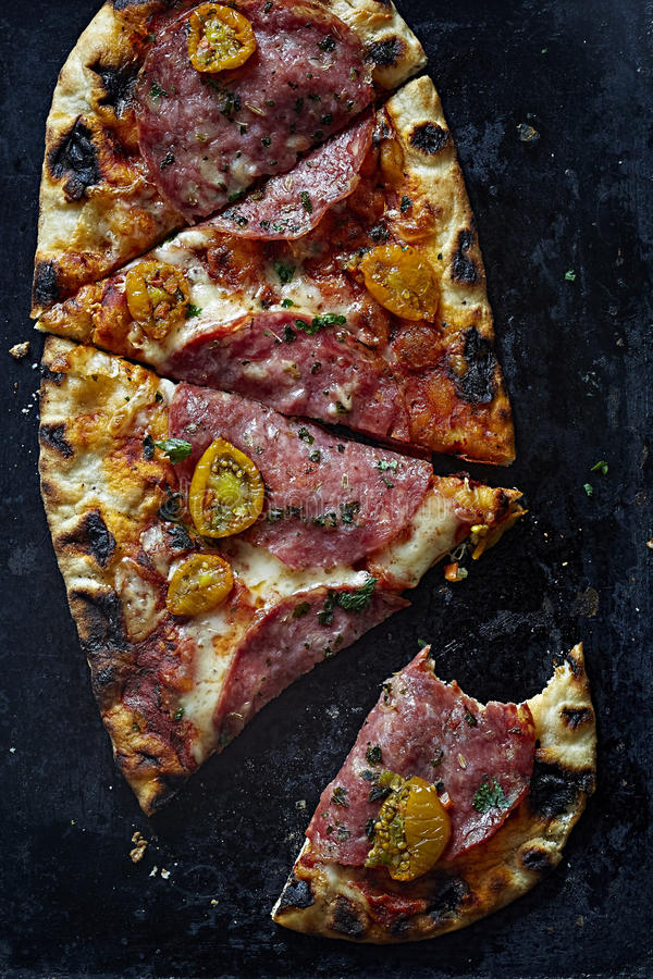 Pizza with salami, tomatoes and mozarella stock photos
