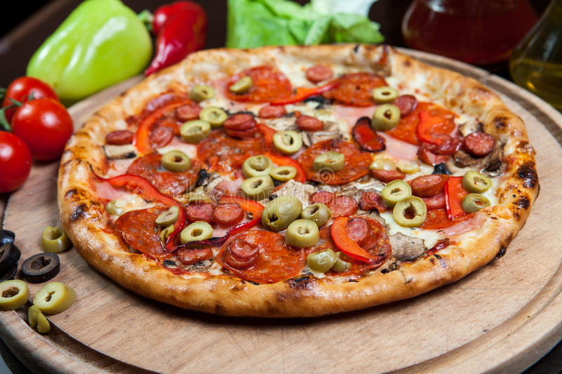Pizza Salamy And Green Olives Royalty Free Stock Photos