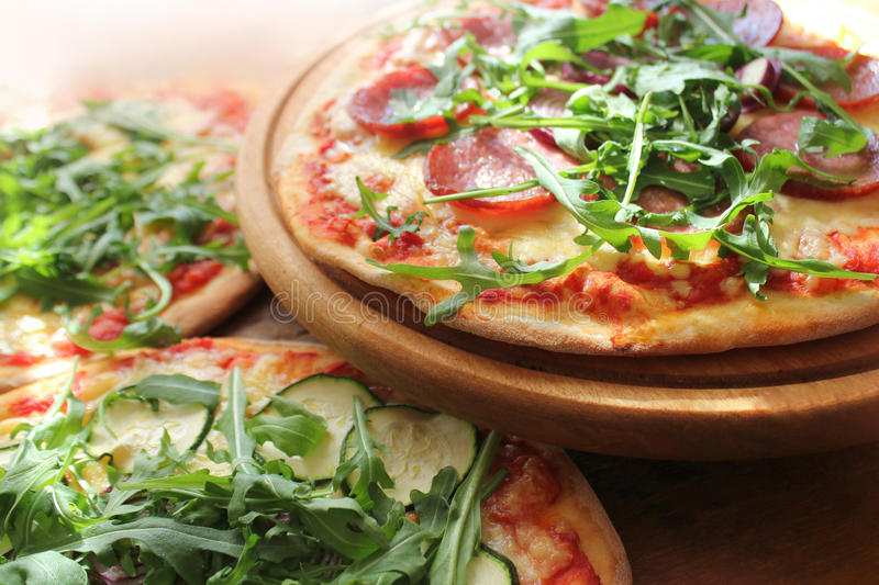 Pizza with sausage, cheese, ruccola stock photos