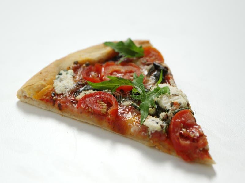 Pizza slice. Garnished and isolated on white background stock photo