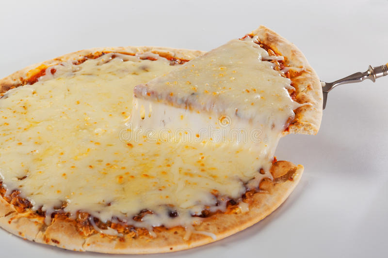 Pizza slice with melted mozzarrella stock photo