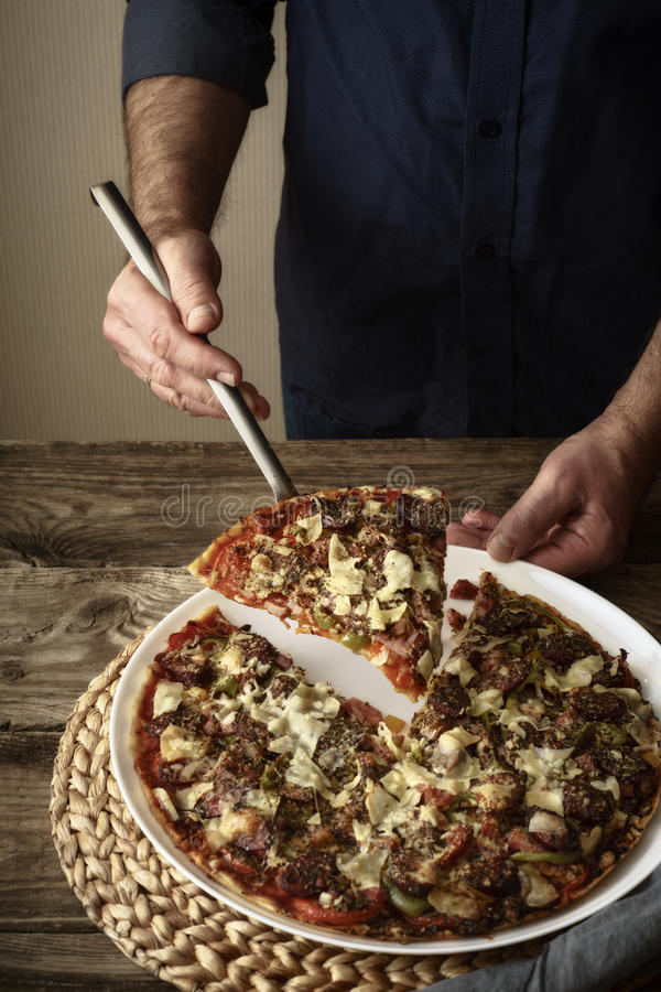 Download Pizza And A Slice Of Pizza On A White Dish Stock Photo - Image: 83711127