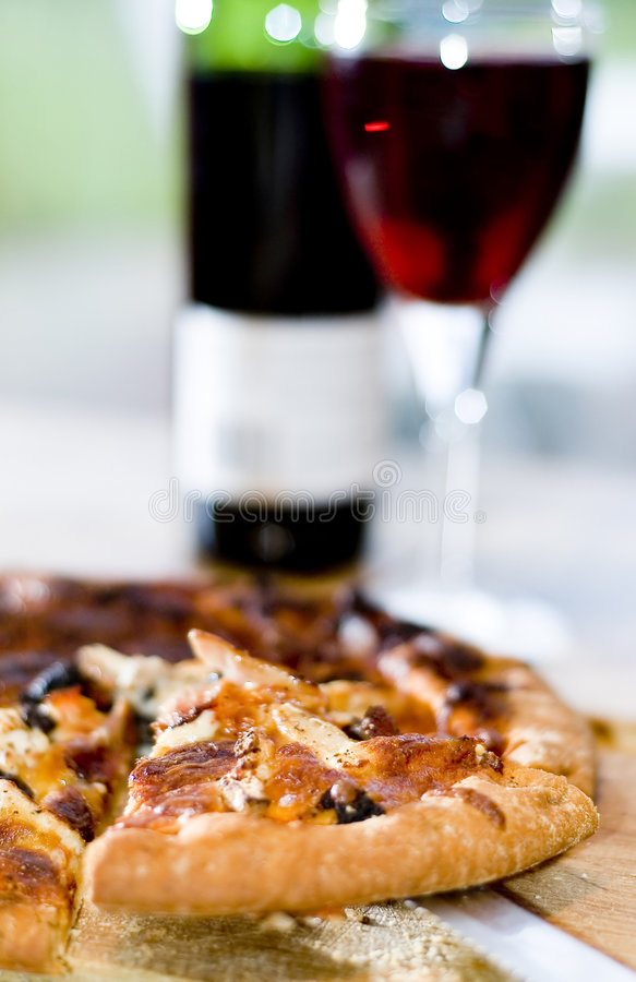 Pizza slice and wine royalty free stock photo