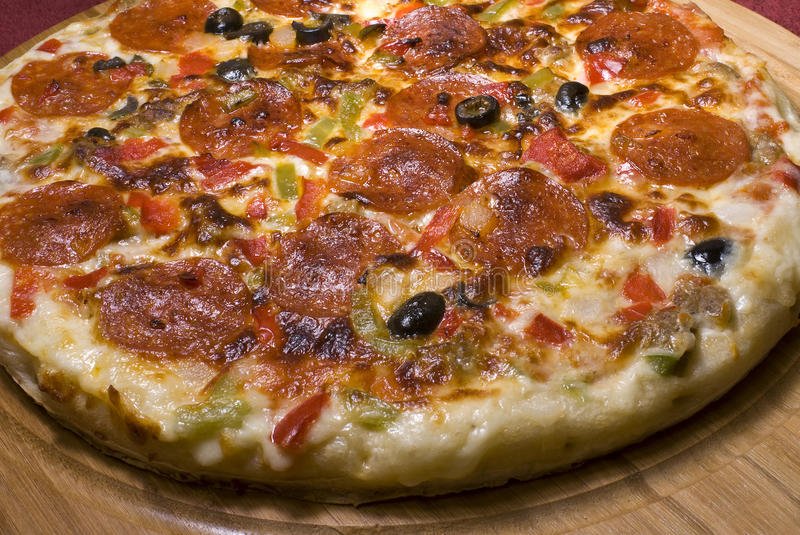 Pizza Supreme. Whole pizza pie with all the toppings stock images
