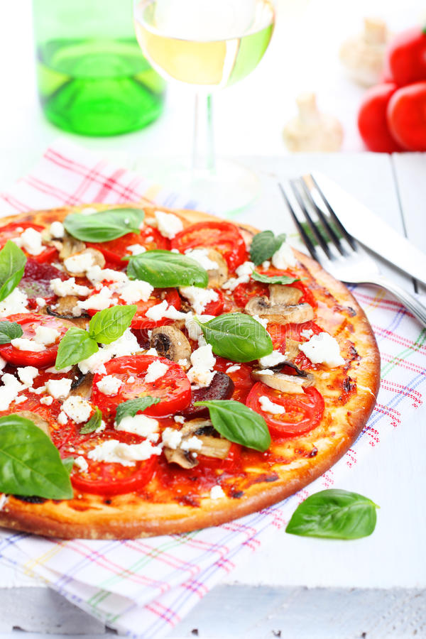 Download Pizza With Tomatoes And Mushrooms Stock Images - Image: 15104984