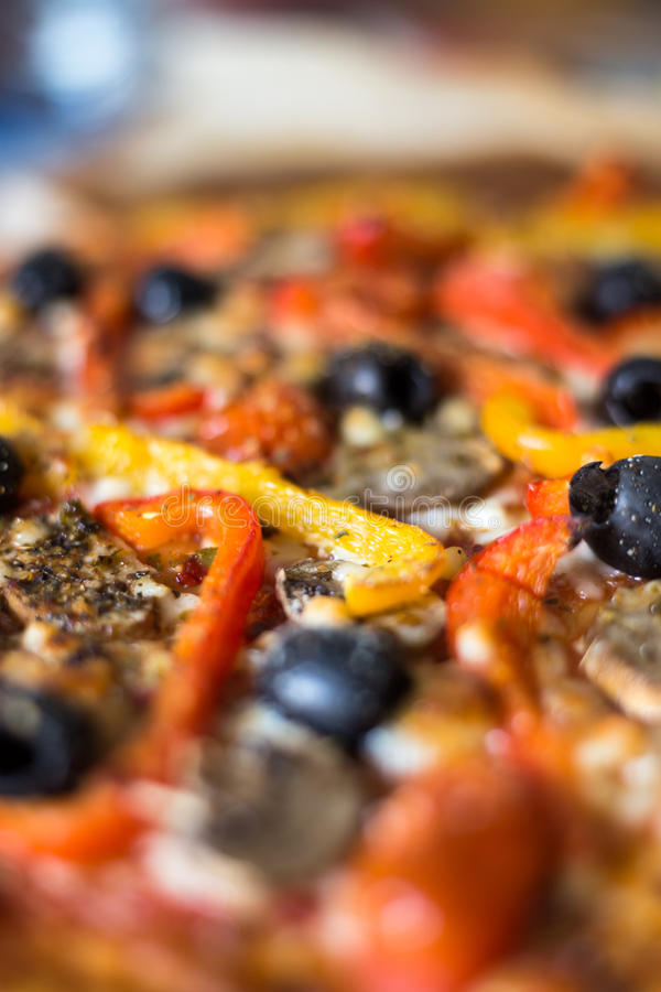 Pizza topping macro. With olives and vegetables stock photo