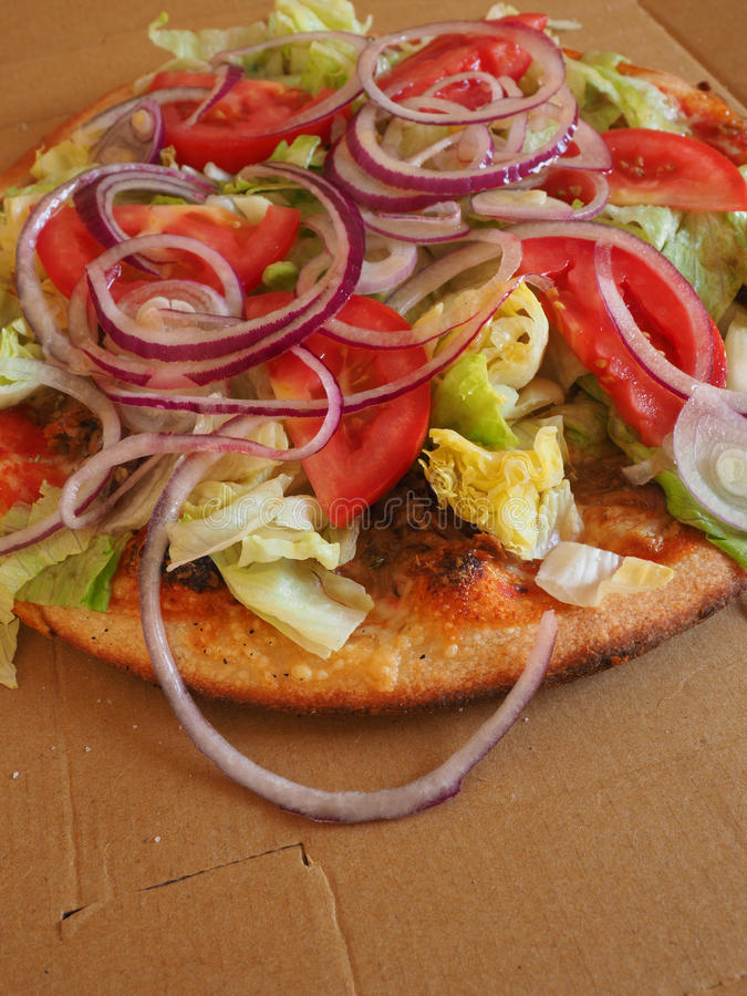 Pizza with tuna and lettuce stock image