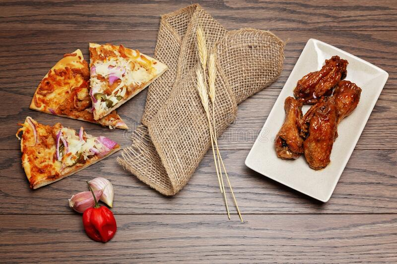Pizza and wings flatlay royalty free stock images