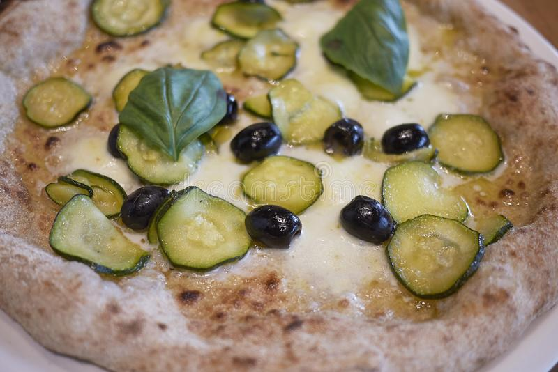 Pizza with zucchini and black olives. Closeup stock photos