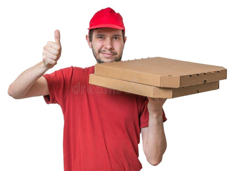 Pizzalieferungskonzept Junge liefert Pizza in den Kästen lizenzfreies stockbild