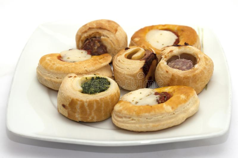 Pizzas and savory appetizer pretzels.  royalty free stock image