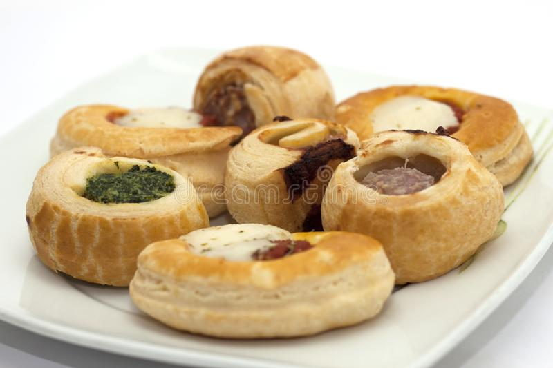 Pizzas and savory appetizer pretzels.  stock image