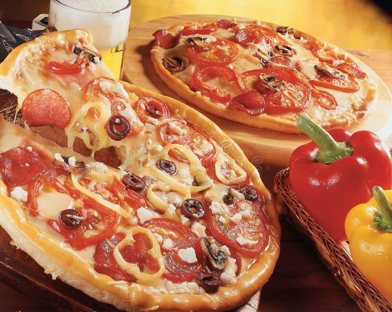 pizzas två fotografering för bildbyråer