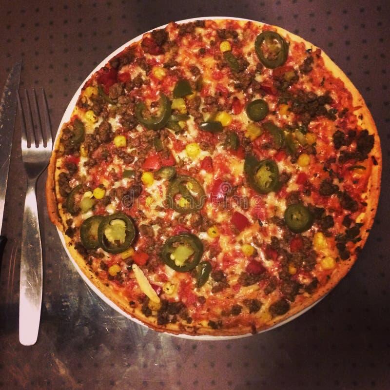 Pizzatijd stock fotografie