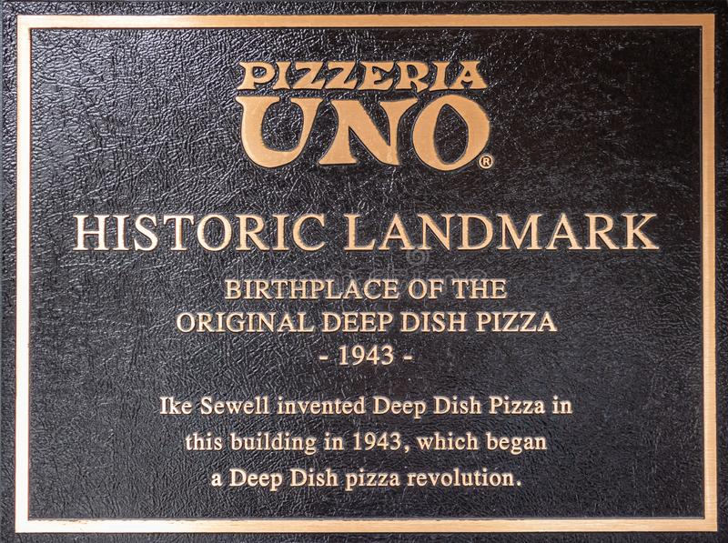 Pizzeria UNO deep dish pizza restaurant, metal information plate at the entrance in Chicago, Illinois royalty free stock images