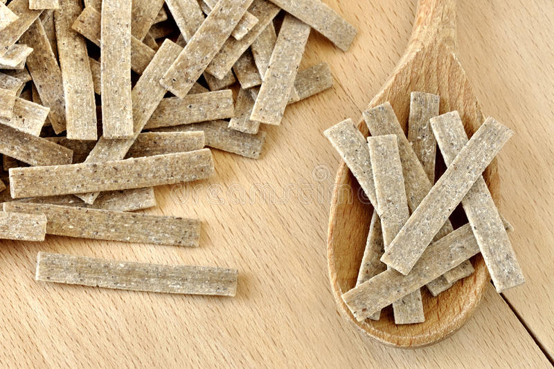 Pizzoccheri, italian pasta. Pizzoccheri on a wooden chopping board, italian pasta, specialty of Valtellina, Italy stock photos