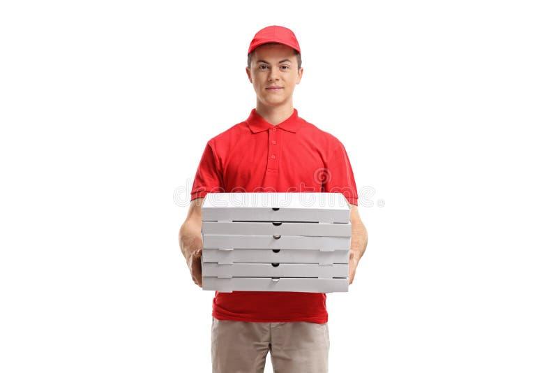 Pizzy doręczeniowa chłopiec trzyma stertę pizza boksuje zdjęcie royalty free
