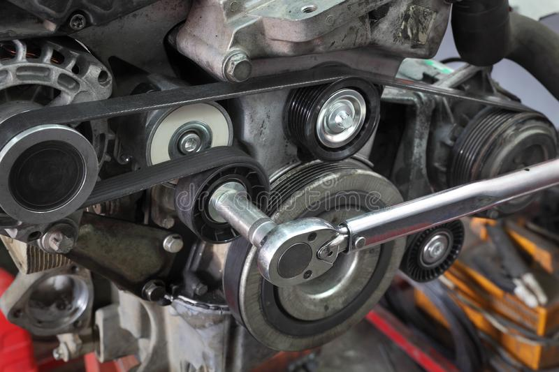 Modern car servicing pulley tightening royalty free stock photography