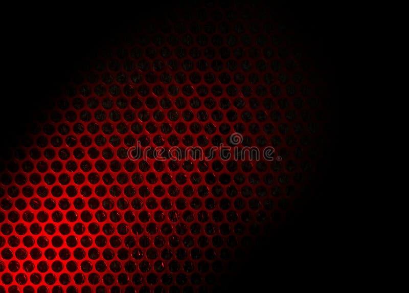 Plástico de burbujas encendido por la luz roja imagenes de archivo