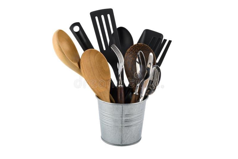 Plástico negro, de madera, desnatadora determinada de la cocina del metal, espada del fryin imagenes de archivo
