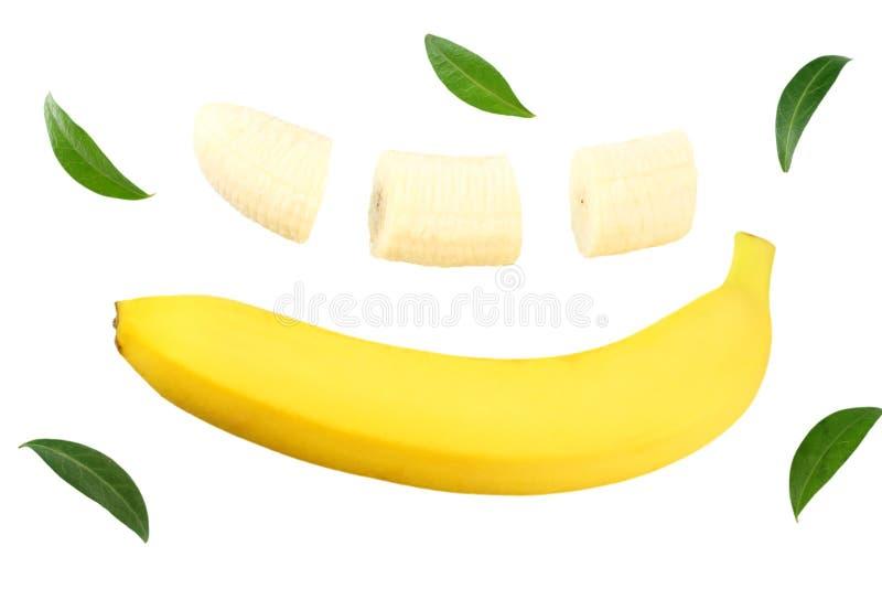 plátano cortado con las hojas verdes aisladas en el fondo blanco Visión superior foto de archivo