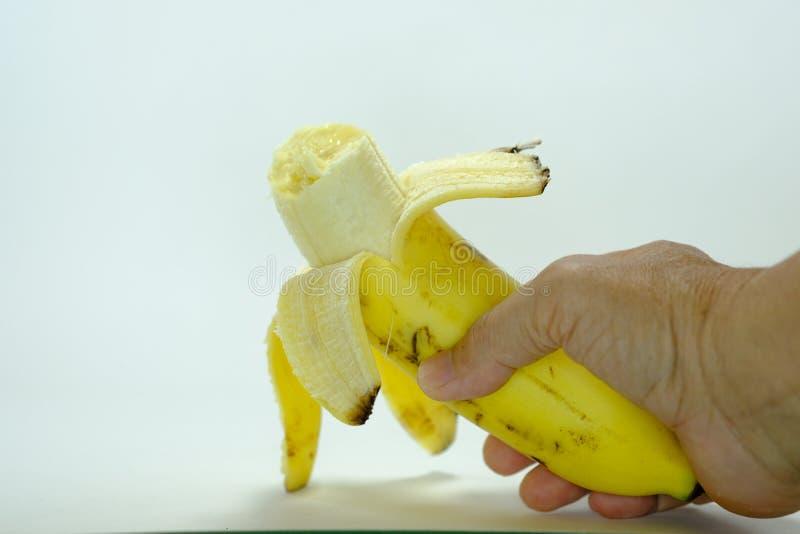 Plátano una fruta curvada larga que crece en racimos y tiene p suave fotografía de archivo libre de regalías