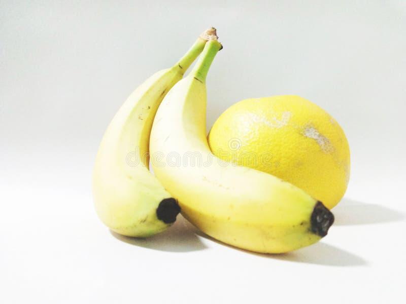 Plátano y pomelo de la fruta imágenes de archivo libres de regalías