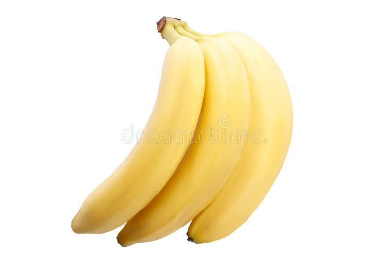 Plátanos maduros hermosos en un fondo blanco aislamiento imagen de archivo