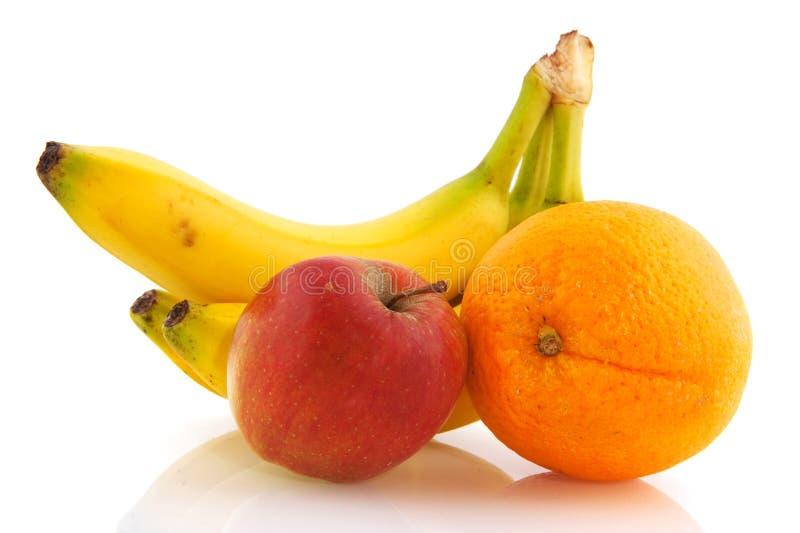 Plátanos manzana y naranja foto de archivo libre de regalías