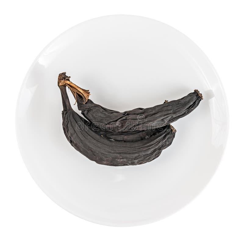 Plátanos putrefactos en la placa blanca fotografía de archivo libre de regalías