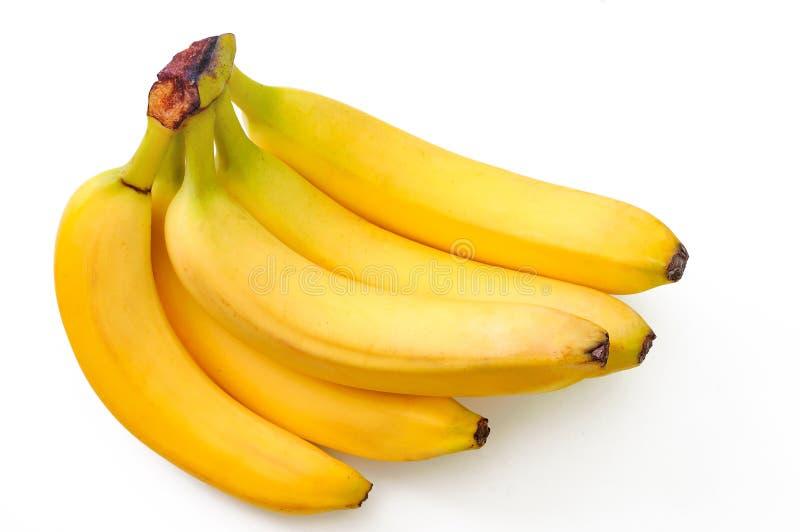 Plátanos sabrosos aislados en el blanco imágenes de archivo libres de regalías