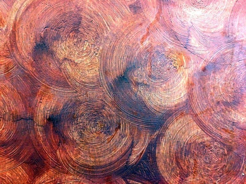 Plâtre foncé abstrait de cercle de couleur d'écarlate sur le mur de ciment comme le tronc en bois images libres de droits