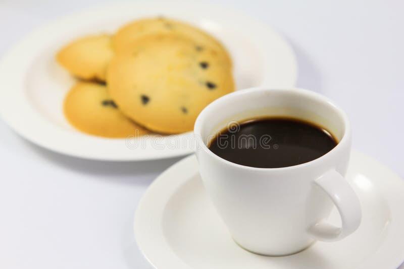 Plätzchen mit Kaffee lizenzfreies stockfoto