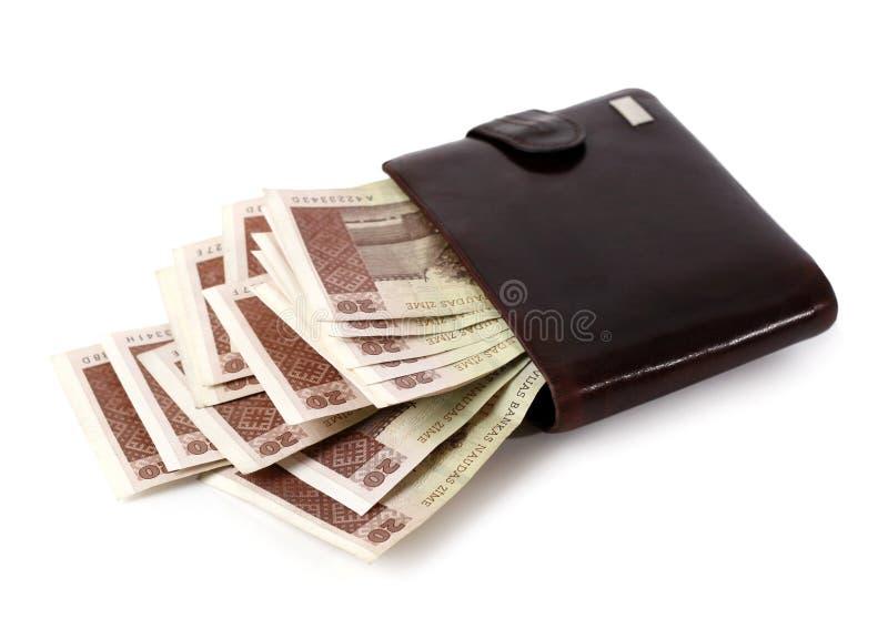 Plånbok full av pengar arkivbild