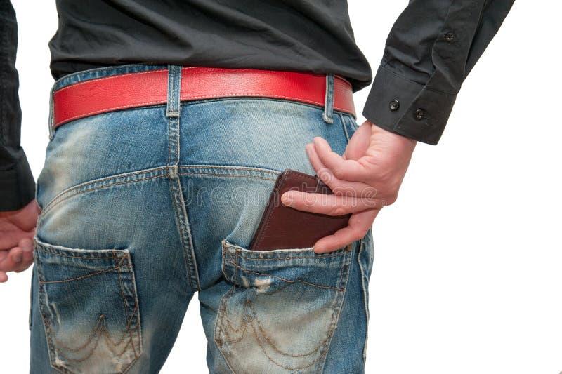Plånbok i manliga händer arkivfoto