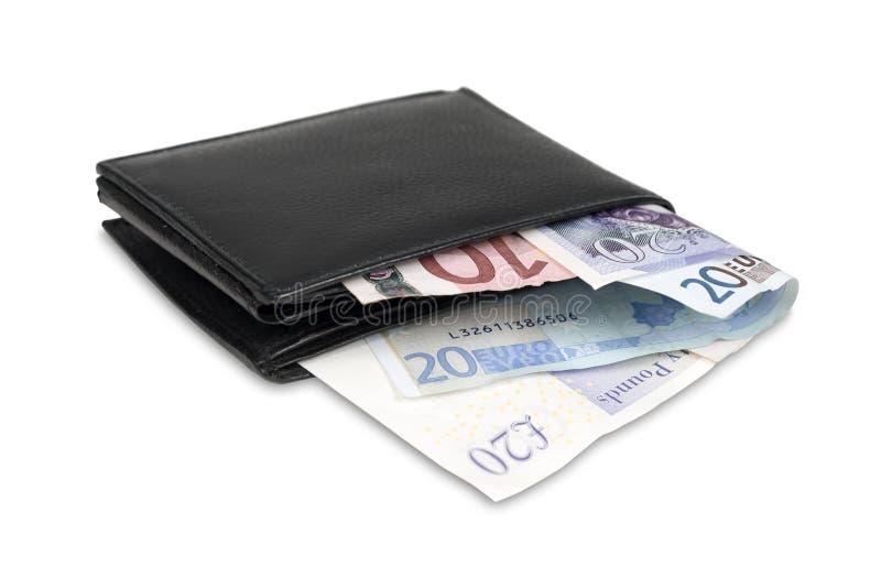 Plånbok med euro- och pundsedlar fotografering för bildbyråer