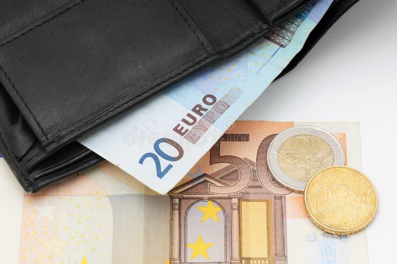 Plånbok och pengar. royaltyfria foton