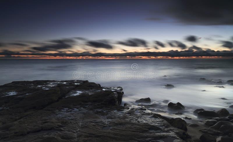 Plaża przy półmrokiem obrazy royalty free